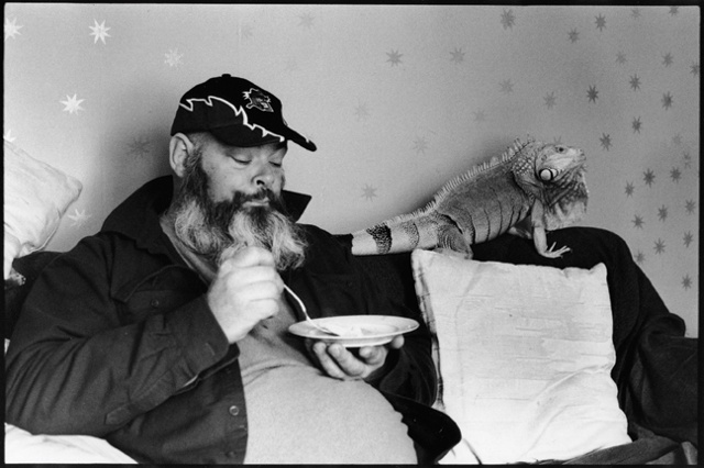 Bill eats cereal in his living room in Freeport, Maine, with his 25 year old iguana, Mogwana.