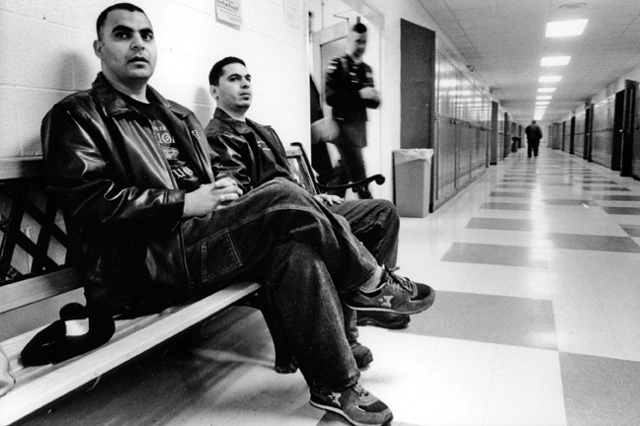 "Shark and Steve wait in the hallway at Belfast High School, to speak at a conference on ""Muslim Unity""."