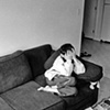 Faysel's son sits shyly on the couch the day before the big move to Portland from Lewiston, Maine.