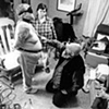 """Bill, Suu and Sue """"play"""" in their living room in Freeport, Maine."""