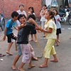 Children play on a back street in Ho Chi Minh City.