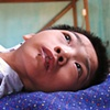 This boy is paralyzed due to his father's exposure to Dioxin during Vietnams war with Cambodia, remnants from before 1975.