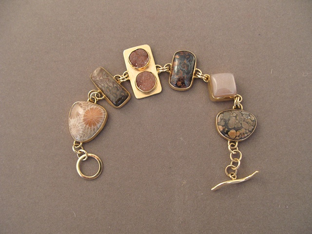 14kt gold, stones:  fossil coral, fossil pine cone, druzy, petersite, orange moonstone, obincular jasper
