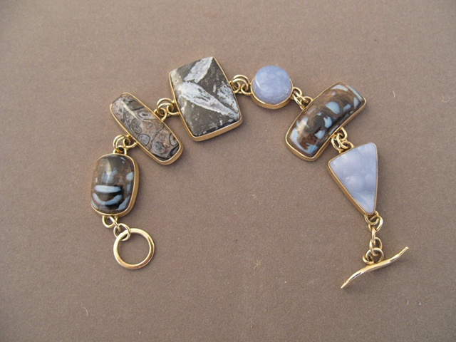 14kt gold, stones:  petrified wood, fossil palm, sagenite, blue chalcedony, petrified wood, botryoidal chalcedony