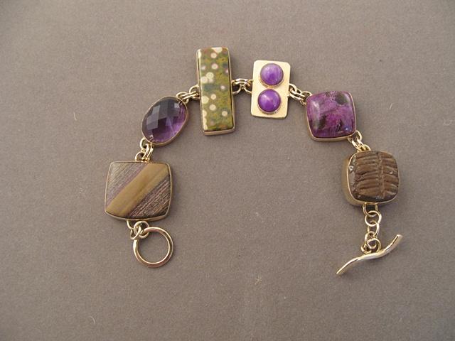 14kt gold, stones:  jasper, amethyst, poppy jasper, sugelite, stitchtite, fossil tree fern