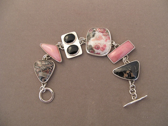Sterling Silver, stones:  crinoid fossil, rhodocrosite, onyx, garnet, rhodocrosite, concretion
