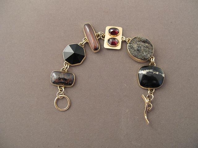 14kt gold, stones: petersite, onyx, tiger iron, garnet, garnet in schist, pyrite in onyx