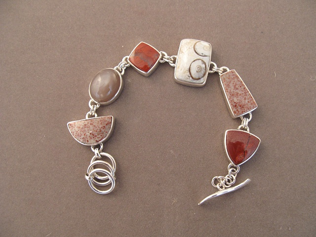 Sterling Silver, stones:  red spotted jasper, moonstone, red river jasper, petrified palmroot, red spotted jasper, red river jasper
