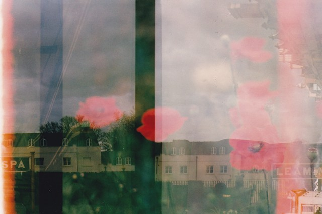 A lo-fi multiple exposure film photo of poppies, flowers, Oxford, and Leamington Spa, England.  Sky, architecture, burn, and soft colours.