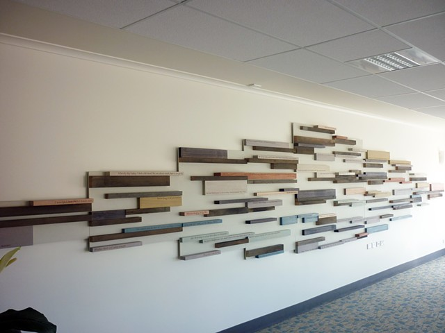 A sculptural wall relief featuring laser engraved timber