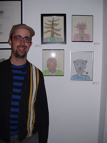 Photograph of artist Christopher Stanton with his drawings