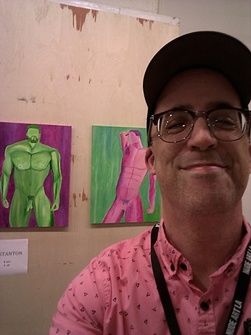 Artist Christopher Stanton with his acrylic nude paintings