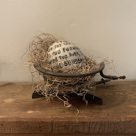 Text egg in stove element with Spanish moss
