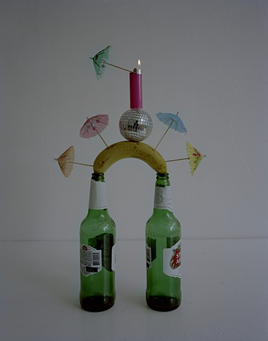 Beer Bottles, Banana, Cocktail Umbrellas, Disco Ball and Bic Lighter
