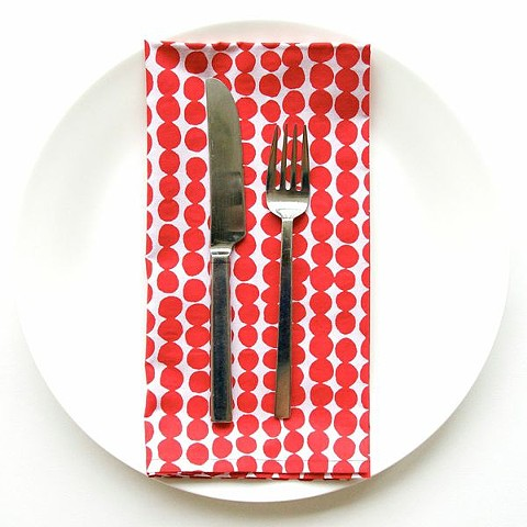 drops red dinner napkin