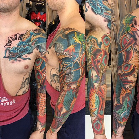 Dragon and Phoenix With Philippine Sun Tattoo By Curt Semeniuk Color Crimson Empire Tattoo