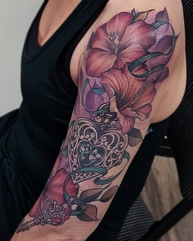 Flowers With Locket Tattoo By Sasha Roussel Color Black Gold Tattoo Co