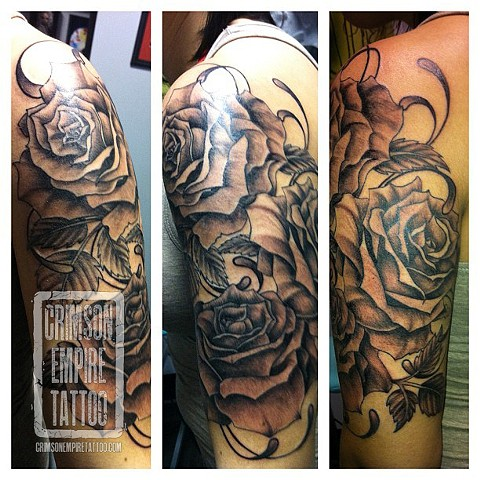Black and grey flowers on bicep by Jessica Alther
