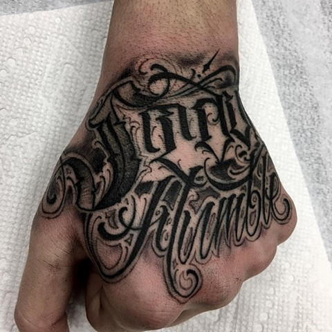 Script Tattoo By Romeo Ostiguy Black And Grey Black Gold Tattoo Co