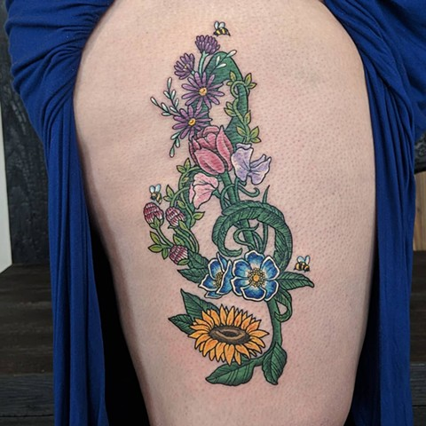 Floral Treble Clef Thigh Tattoo by Sheila Anderson color Crimson Empire Tattoo