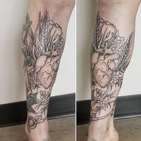 Anatomical Heart with Flowers Leg Tattoo by Adrienne Alexander Black Work Crimson Empire Tattoo
