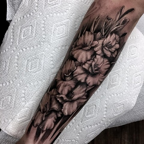 Gladiolus Tattoo By Romeo Ostiguy Black And Grey Black Gold Tattoo Co
