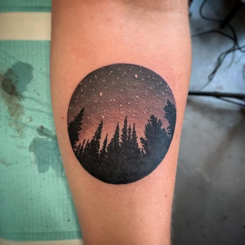 Circle Night Sky Forearm Tattoo By Dale Moostoos Black and Color Crimson Empire Tattoo