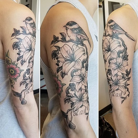 Lillies and Bird Sleeve Tattoo by Adrienne Alexander Black work Crimson Empire Tattoo