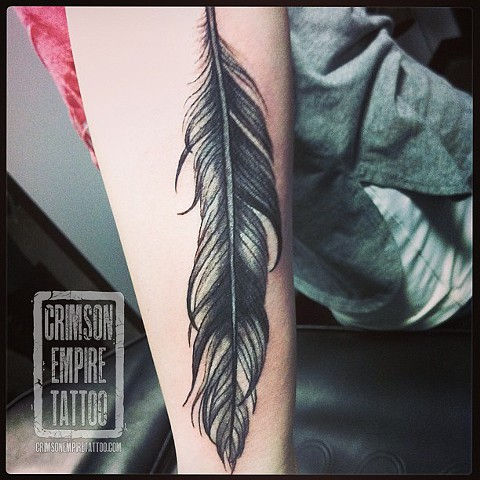 Feather on forearm by Jessica Alther