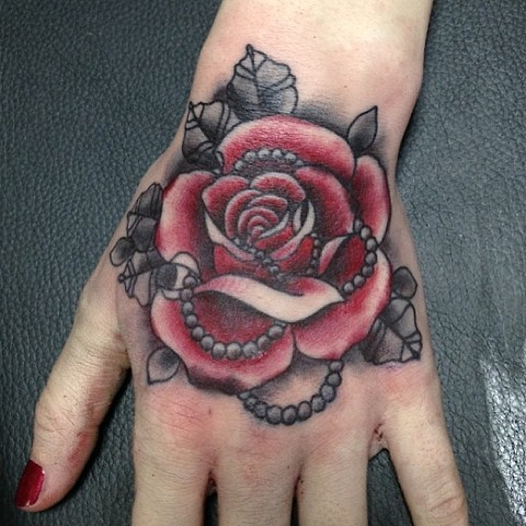 Rose on hand by Sydney Dyer