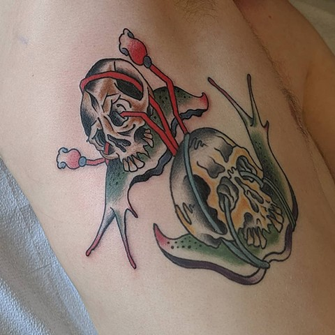 Traditional Slugs with Skull Ribs Tattoo By Chris Benson Color Crimson Empire Tattoo