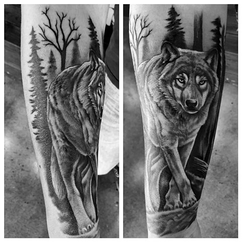 Wolf in Trees Leg Tattoo By Chad Lavers Black and Grey Crimson Empire Tattoo