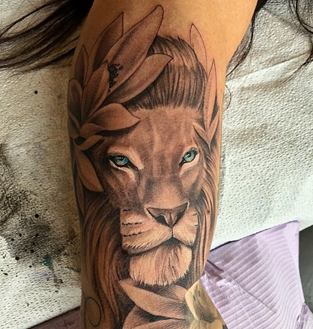 Lion with Blue Eyes And Lilies Tattoo By Chad Lavers Black And Grey With Color Crimson Empire Tattoo