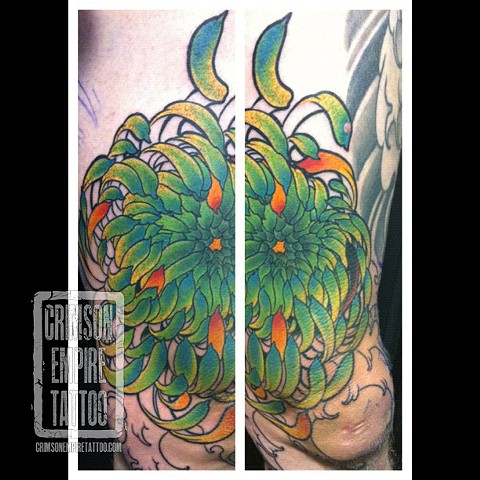 Green flower on arm and elbow by Jared Phair. Follow Jared @jroctizzle