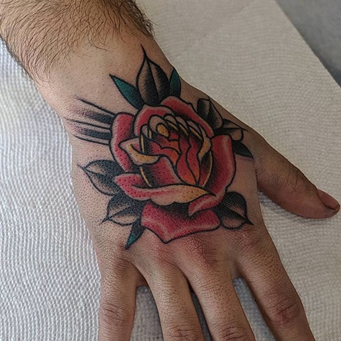 Traditional Rose Hand Tattoo By Chris Benson Color Crimson Empire Tattoo