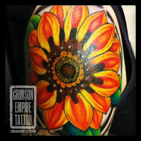 Orange Flower on shoulder by Jessica Alther