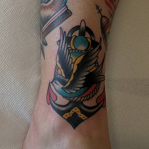 Traditional Anchor and Swallow Ankle tattoo by Chris Benson Color Crimson Empire Tattoo