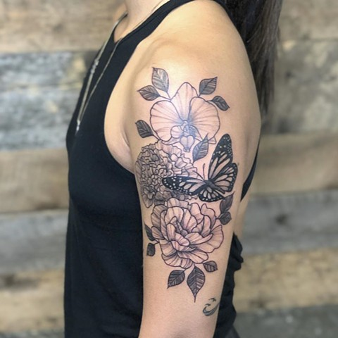 Floral Upper Arm Tattoo by Vanessa Spezowka Black and Grey Crimson Empire Tattoo