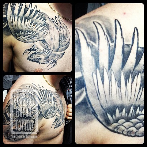 Phoenix on chest and bicep by Chad Clothier