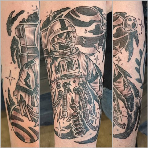 Astronaut Skeleton Arm Tattoo by Sheila Anderson Black and Grey Crimson Empire Tattoo