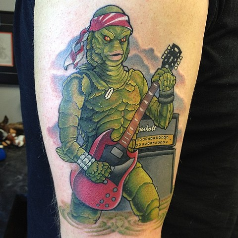 Creature From The Black Lagoon As a Rock Star Tattoo By Marshall Khalil Color Crimson Empire Tattoo