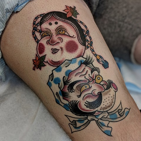 Traditional Faces Thigh Tattoo by Chris Benson Color Crimson Empire Tattoo