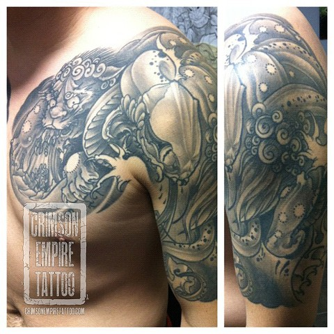 Dragon on left shoulder by Jared Phair