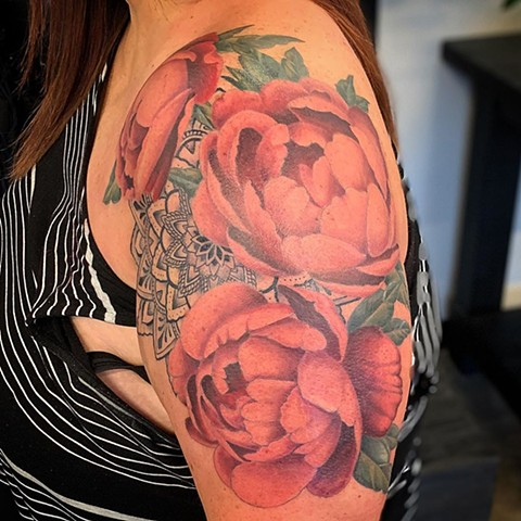 Flowers and Mandala Upper arm Tattoo by Dale Moostoos Color Crimson Empire Tattoo