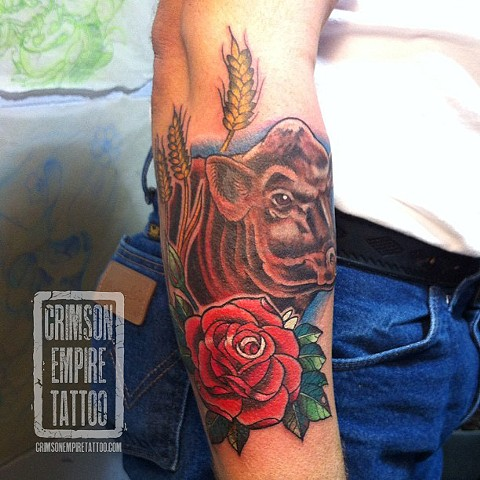 Bull and roese on forearm by Curt Semeniuk