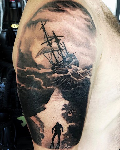 Ship in Storm Arm Tattoo By Chad Lavers Black and Grey Crimson Empire Tattoo