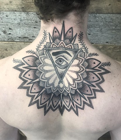 Eye Mandala Back tattoo By Cheyanne Kot black work Crimson Empire Tattoo
