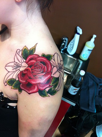 rose lillies on shoulder