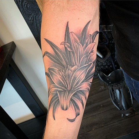 Lillies Arm Tattoo by Dale Moostoos Black and Grey Crimson Empire Tattoo