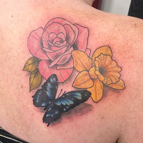 Flowers and Butterfly Shoulder Tattoo by Vanessa Spezowka Color Crimson Empire Tattoo